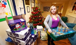 Volunteer Vicki Hutchison helps with The Cottage community centre Christmas appeal.