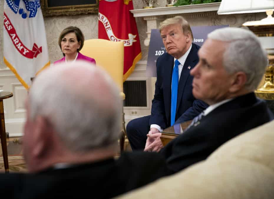 Kim Reynolds, governor of Iowa, from left, U.S. President Donald Trump listens and U.S. Vice President Mike Pence listen during a meeting in the Oval Office of the White House in Washington, D.C., U.S., on Wednesday, May 6, 2020. Trump fixed his course on reopening the nation for business, acknowledging that the move would cause more illness and death from the pandemic but insisting it's a cost he's willing to pay to get the economy back on track.
