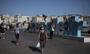 A woman at Marseille port in face mask.