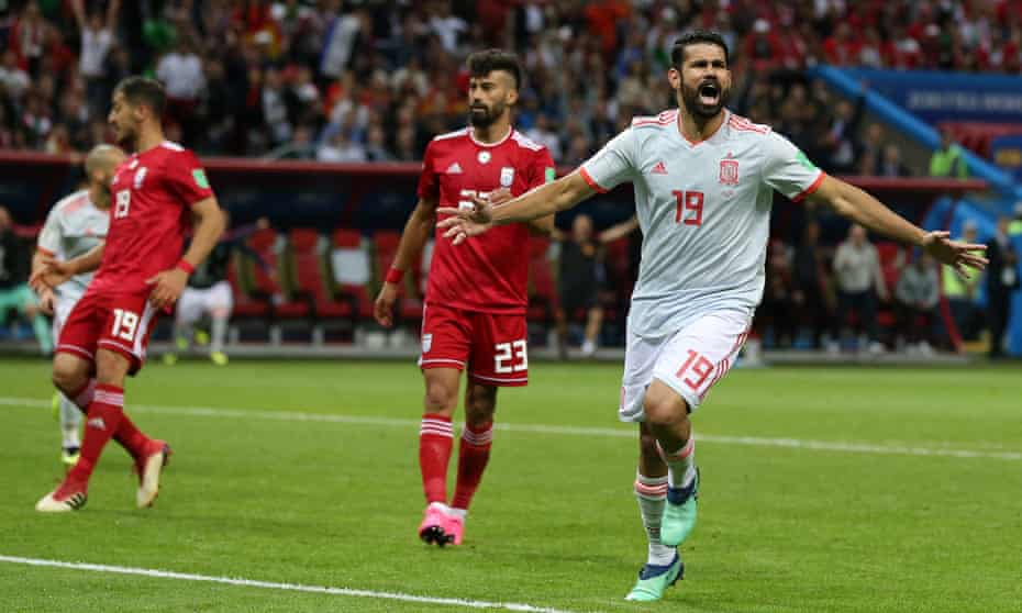 Diego Costa celebrates after scoring the winning goal for Spain.