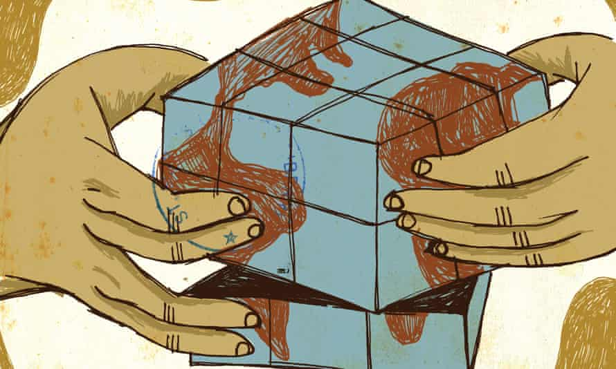 Human hands playing with a puzzle with a pattern of the globe on it