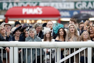 A variety of faces and expressions as punters watch a race