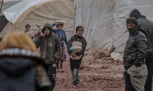 Refugees at a camp in Idlib, northeast Syria