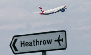 A British Airways plane taking off from Heathrow airport and, at the forefront of the photo, is a road sign pointing in the opposite direction – to Heathrow.