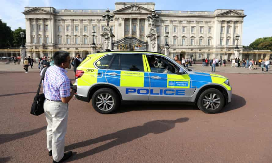 A police vehicle patrols outside Buckingham Palace the day after the incident.