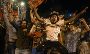 Supporters of Pakistan's cricketer-turned politician Imran Khan, head of the Pakistan Tehreek-e-Insaf (Movement for Justice) party, celebrate during general election in Lahore