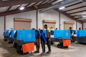 People cast their ballots at an early voting location at the Gwinnett county fairgrounds on 24 October in Lawrenceville, Georgia.
