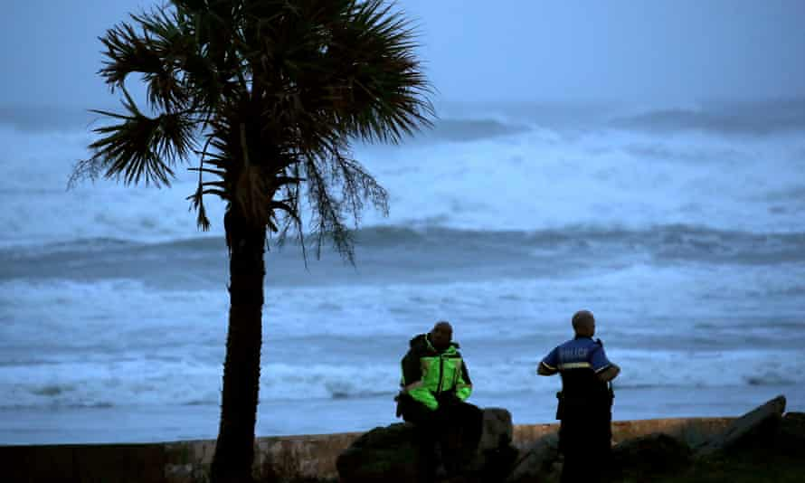 Two Daytona Beach police officers patrol the beach as heavy surf from Hurricane Dorian pounds the sand on Wednesday.