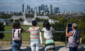 People look out at the London skyline from Greenwich Observatory.