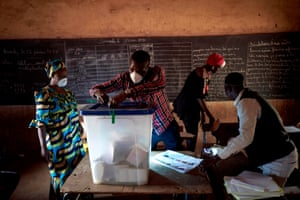 Bamako, MaliAn electoral official wearing a mask removes the seals of a ballot box at a polling station. Malians headed to the polls for a long-delayed parliamentary election just hours after the country recorded its first coronavirus death