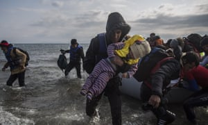 Refugees reach the Greek island of Lesbos on Saturday. More than one third of refugees entering Europe go to Germany.