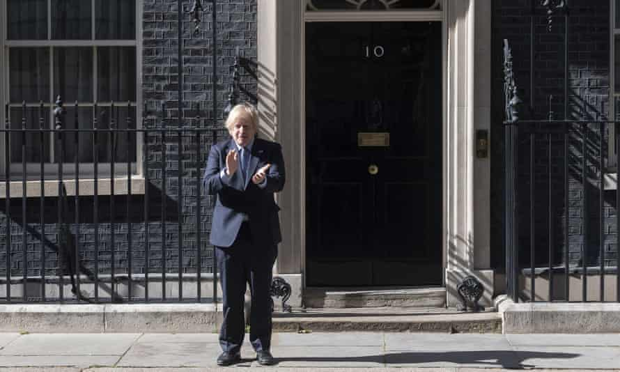 Boris Johnson clapping outside No 10 in London to mark the 72nd anniversary of the NHS, 5 July 2020.