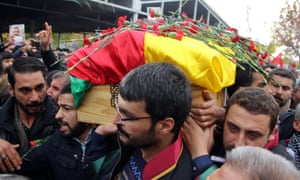 Tahir Elci's coffin is carried by mourners on Sunday