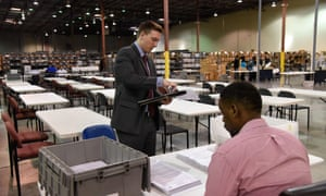 Palm Beach county election officials prepare to recount ballots on Thursday in West Palm Beach, Florida.