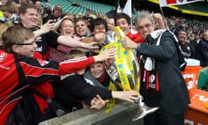 Saracens chairman Nigel Wray celebrates with fans after winning the Premiership final in 2011