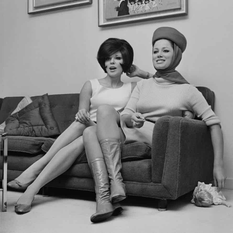 Jackie Collins, right, with sister Joan in 1966.