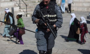 An Israeli policeman on patrol next to the Damascus Gate of the Old City district of Jerusalem on 19 February 2016 as security was stepped up