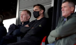 Salford City co-owners Paul Scholes and Gary Neville with Roy Keane in the stands during the 2-2 League Two draw against Tranmere.