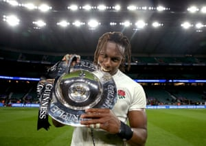 Itoje poses with the Triple Crown Trophy.