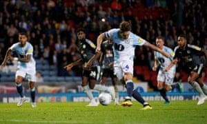 Blackburn Rovers' Charlie Mulgrew scores from the spot.