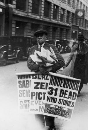 A London news vendor, carrying news of the Hindenburg disaster Fleet Street, London, May 1937.