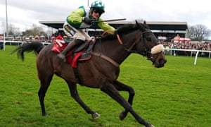Sam Twiston-Davies rides Clan Des Obeaux to victory in the King George VI Chase at Kempton.