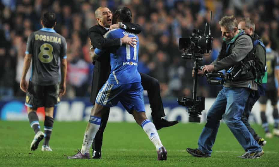 Interim Chelsea manager Roberto Di Matteo embraces Didier Drogba after their stirring Champions League win against Napoli in 2012.