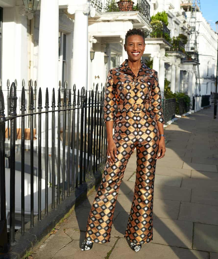Renee Macdonald, founder of Lisou London, photographed outside her house in Notting Hill, in a gold patterned jumpsuit