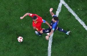Belgium's Eden Hazard hits the deck after the challenge of France's Olivier Giroud.
