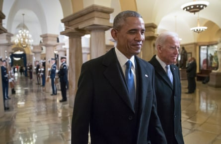 Barack Obama and Joe Biden walk through the Crypt of the Capitol on 20 January 2017.