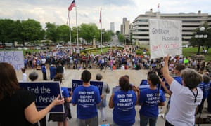 People gather at a rally opposing Arkansas' upcoming executions on Friday in Little Rock.