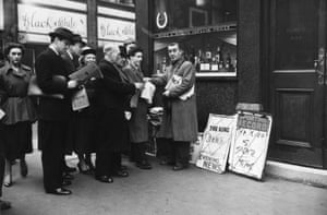 The King Is Dead. People queuing for newspapers on Fleet Street after the news of King George VI's death was announced