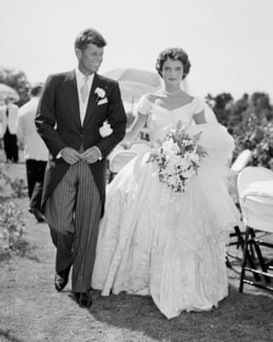 JFK and Jackie Kennedy at their weddingA scene from the Kennedy-Bouvier wedding. Groom John walks alongside his bride Jacqueline at an outdoor reception, 1953. Newport, Rhode Island. (Photo by Bachrach/Getty Images)