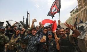 Iraqi federal police celebrate retaking the old city of Mosul on Saturday.