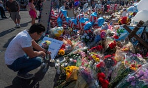 People pray at the makeshift memorial for victims of the shooting that left a total of 22 people dead at a Walmart, in El Paso, Texas, on 7 August 2019.