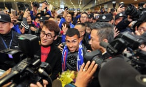 Carlos Tevez is surrounded by fans as he arrives in Shanghai on 19 January 2017.