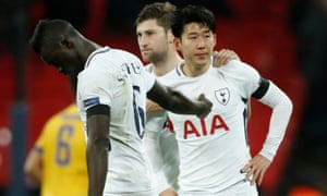 Son Heung-min is consoled by Davinson Sánchez and Ben Davies