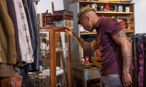 Young black man shopping in vintage clothes store