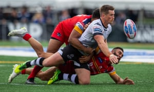Toronto's Josh McCrone tries to get the ball away from the London defenders in the Million Pound Game.