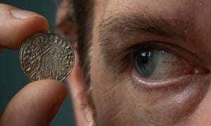 Ian Richardson, treasure registrar at the British Museum, holding a rare example of a mule coin