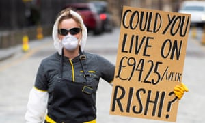 A self-employed woman who was employed by a fast food chain on a contract protests against the level of statutory sick pay, Edinburgh.
