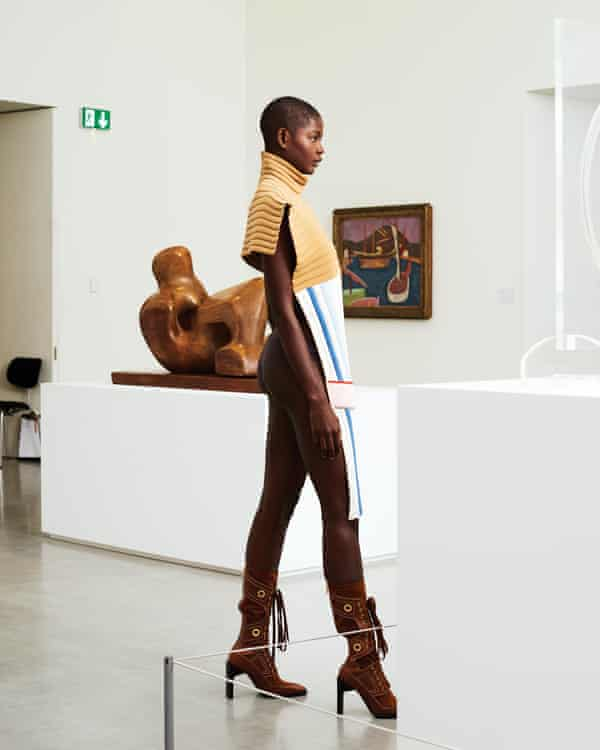 Model in front of Henry Moore and Roger Fry  artworks at JW Anderson exhibition at Hepworth Wakefield