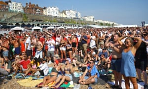 Fans watch the World Cup quarter-final between England and Sweden at the Luna Beach Cinema in Brighton.