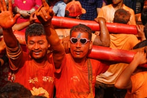Revellers in Thimi, Nepal, smear one another with vermillion powder