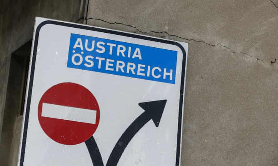 A sign showing the way to the Austrian border in the Italian village of Brennero.