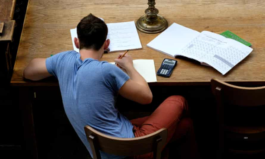 Overhead view of a male student studying