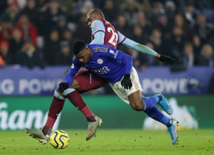 Leicester City's Kelechi Iheanacho goes down under the challenge of West Ham United's Angelo Ogbonna.