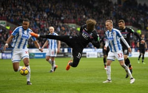 Wilfried Zaha of Crystal Palace attempts a volley as Palace beat Huddersfield 2-0 at the John Smith's Stadium.