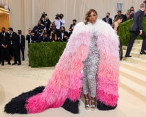 A look befitting the Queen Serena Williams as she arrives wearing a silver Gucci bodysuit and a feathered ombre cape