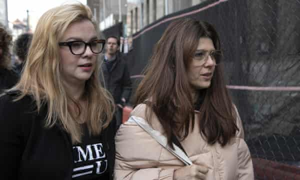 Amber Tamblyn and Marisa Tomei leave court after attending a hearing for Harvey Weinstein in New York on 20 December.
